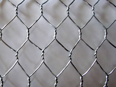 This is a piece of stainless steel wire mesh woven into continuously regular hexagonal meshes.