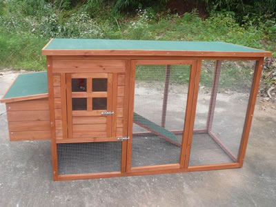This chicken cage is made from solid grooved timber, with a small backyard run for chicken to roam.