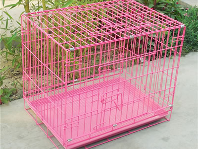 This is a PVC coated pigeon cage with the color of pink, behind the cage is some flowers that look beautiful.