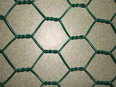 It is a piece of PVC coated wire mesh with hexagonal shape in green color.