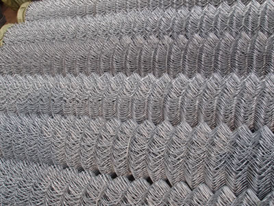 A pile of stainless steel chain link fence roll shown to us in the picture.